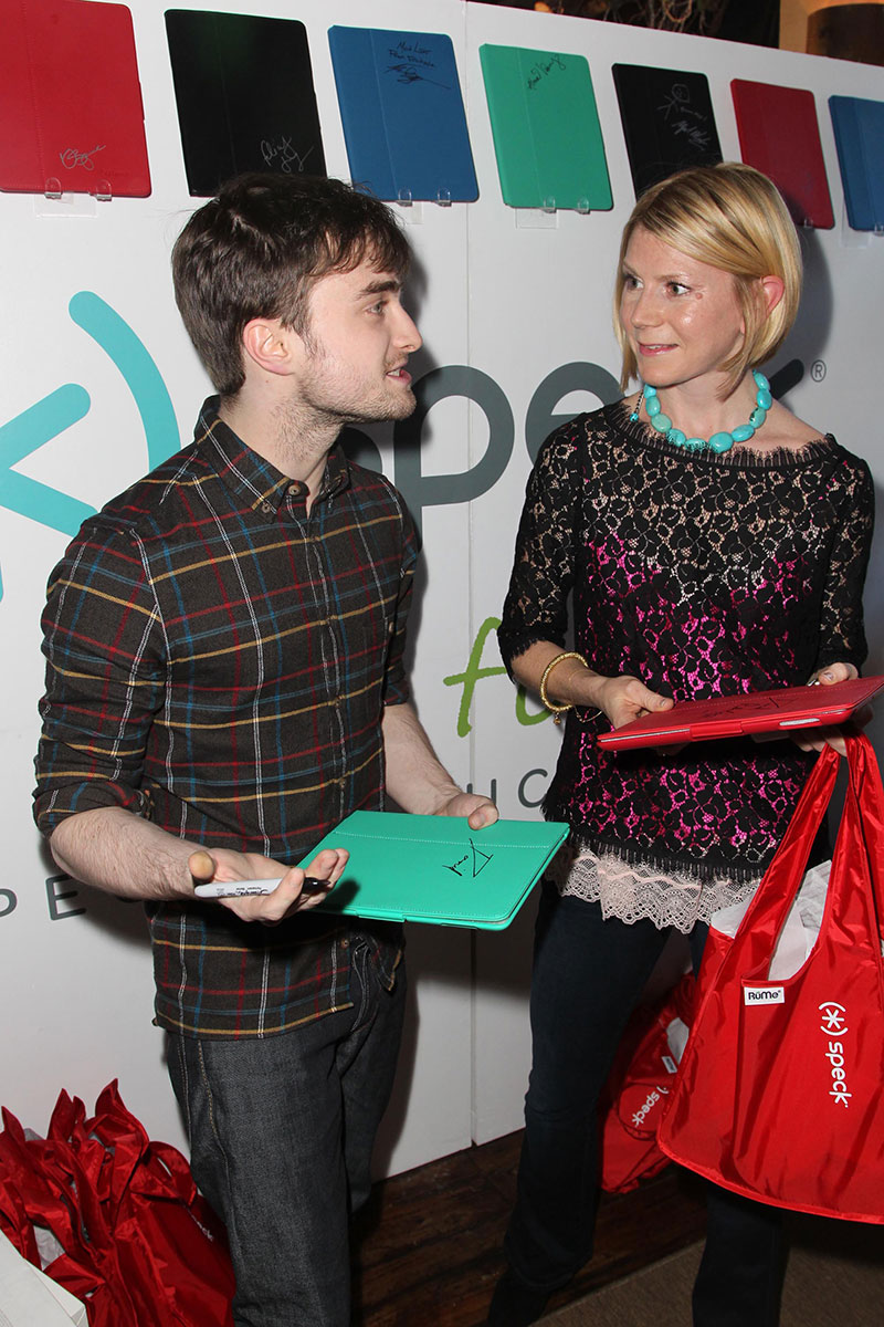 Daniel Radcliffe signs a FitFolio Case for charity at Sundance 2013