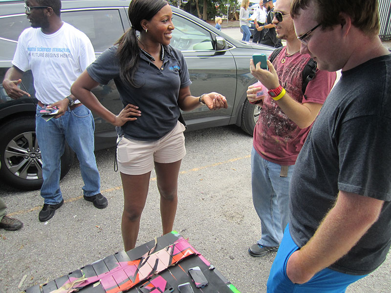 Speck at Miami Mini Maker Faire - Ayanna interacting with a patron
