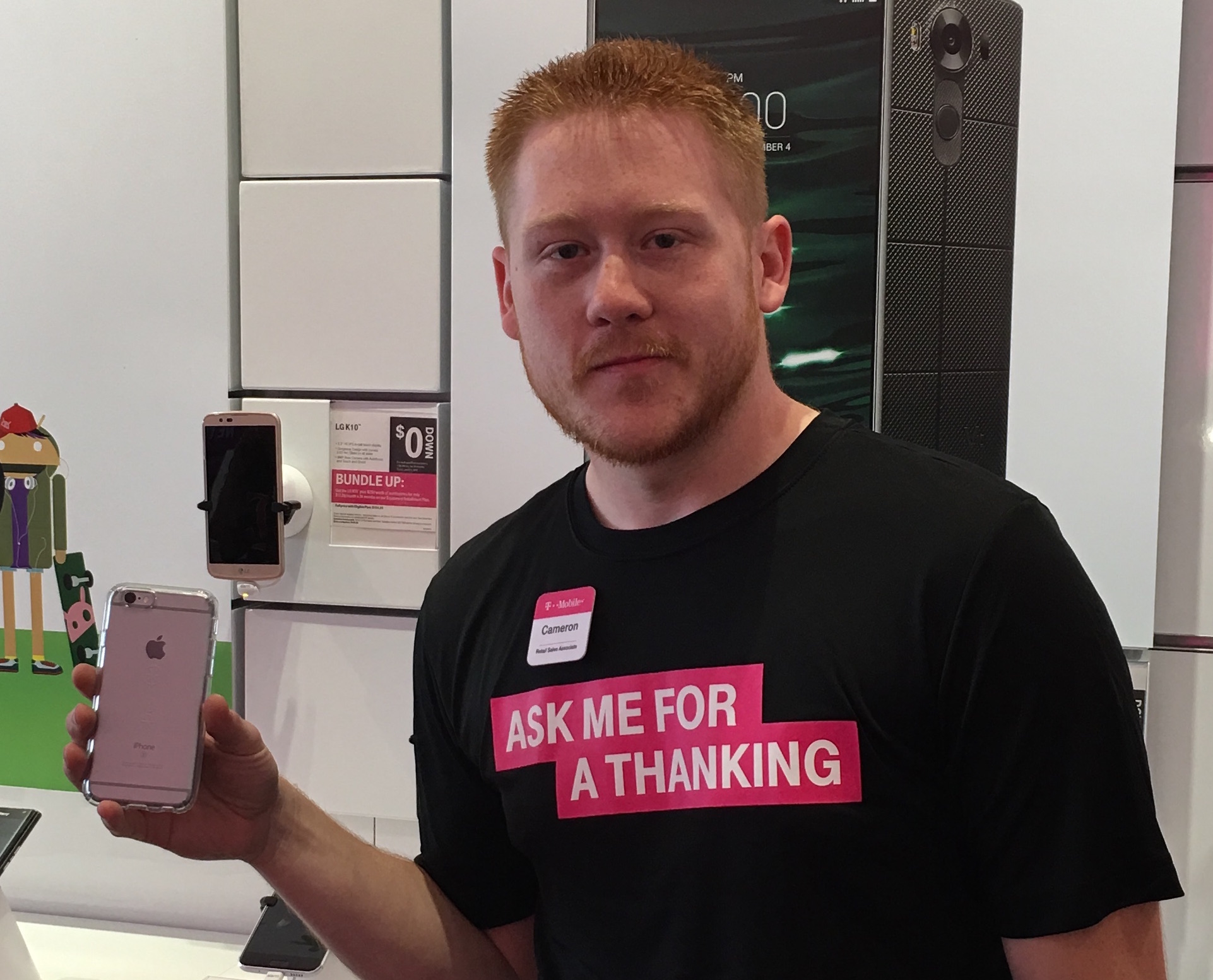 Man holding iPhone with CandyShell Clear case